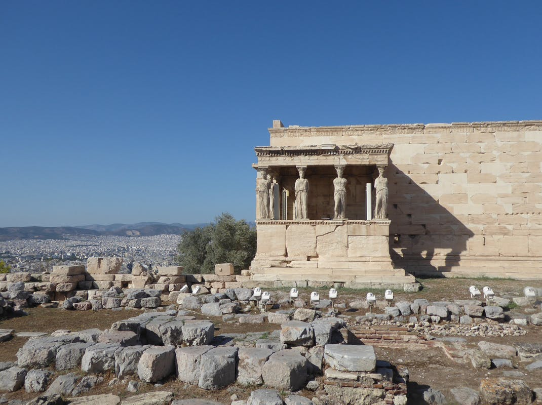 The Erechtheion temple at the Acropolis of Athens in Greece, dedicated to both Athena and Poseidon