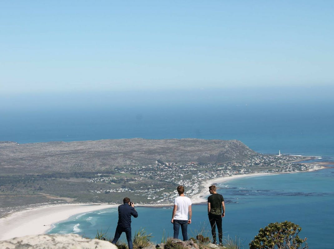 Internship students overlook the ocean South Africa