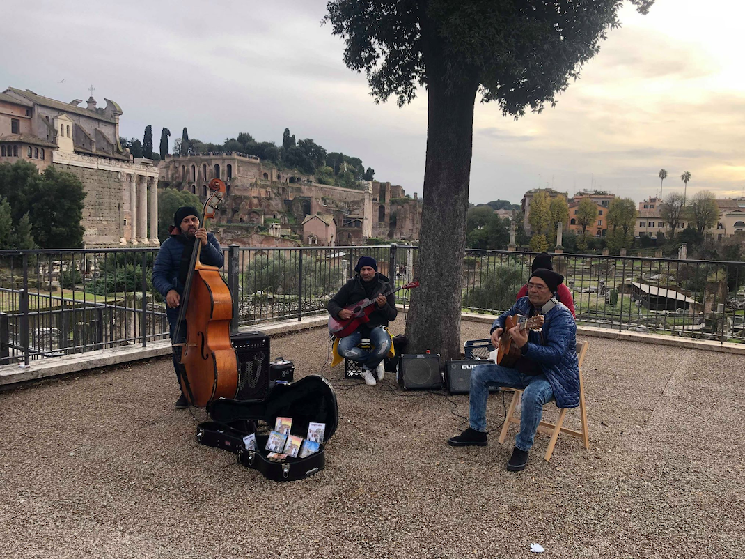 Street musicians play outside the colosseum and Roman Forum, Intern Abroad HQ