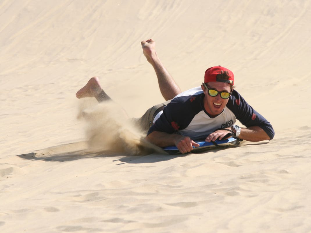 Sandboarding in Cape Reinga, Northland, Bay Of Islands, New Zealand