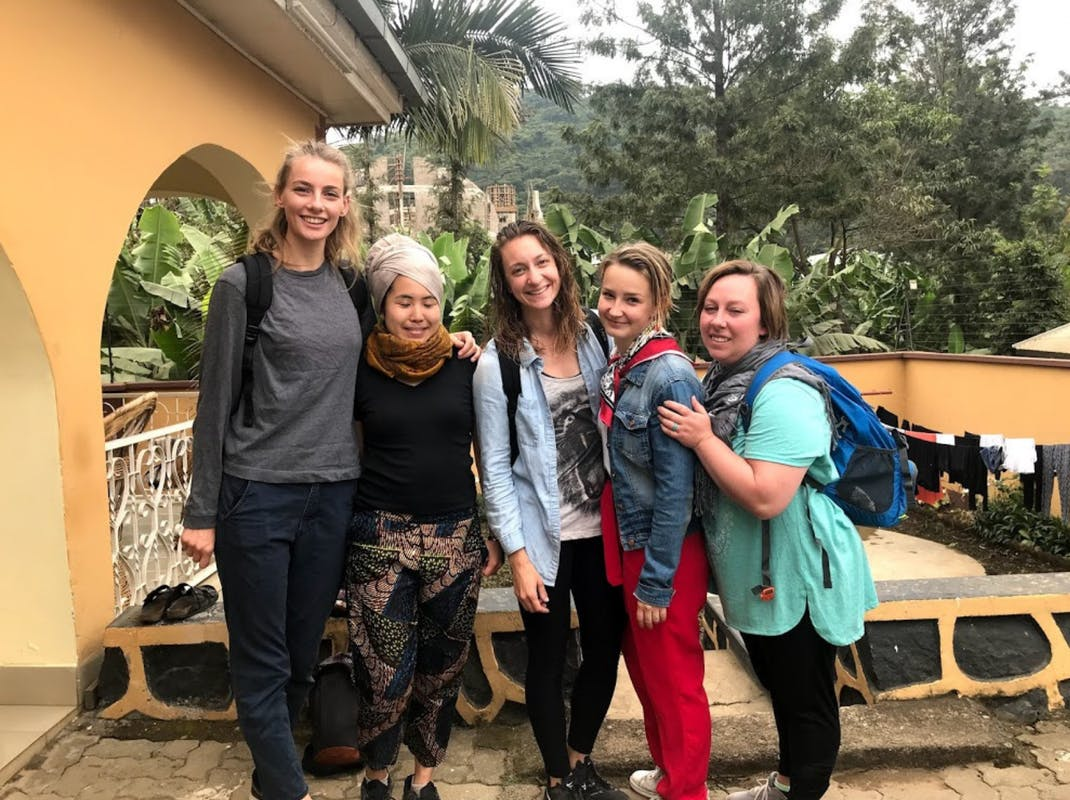 Interns outside the accommodation in Tanzania, Intern Abroad HQ